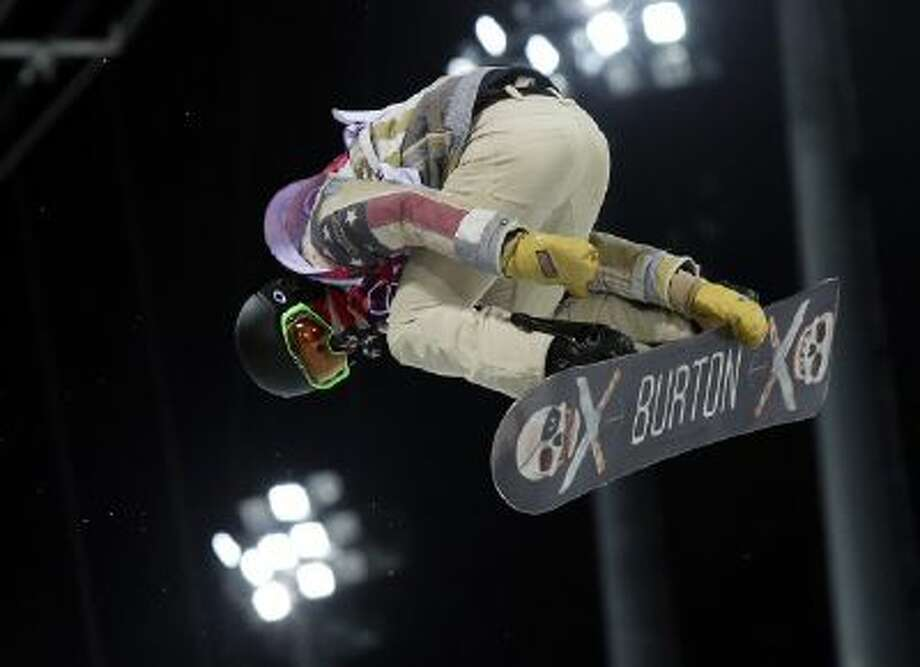 Shaun White of the United States gets air during a snowboard half pipe training session at the Rosa Khutor Extreme Park at the 2014 Winter Olympics, Monday, Feb. 10, 2014, in Krasnaya Polyana, Russia.
