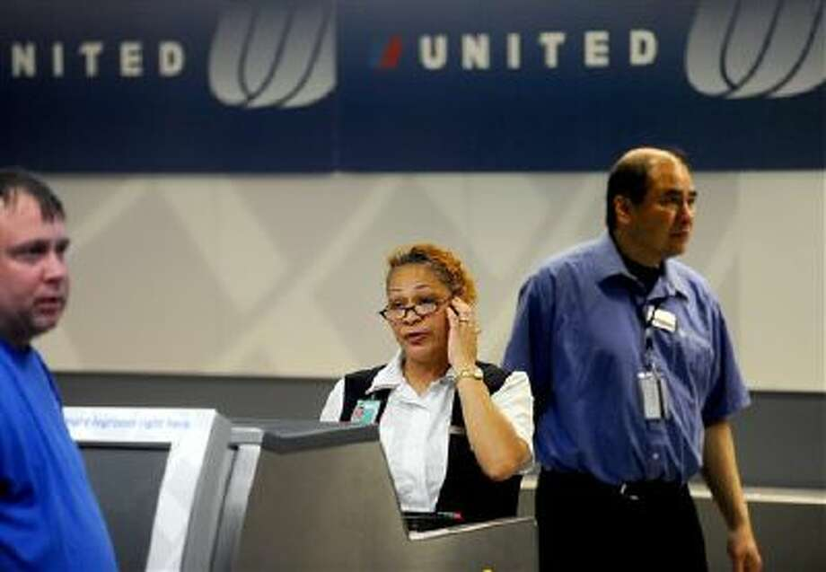 """United Airlines said Saturday it will eliminate 470 jobs in Cleveland, as the airport loses its status as a """"hub."""" Photo: AP / FR34727 AP"""