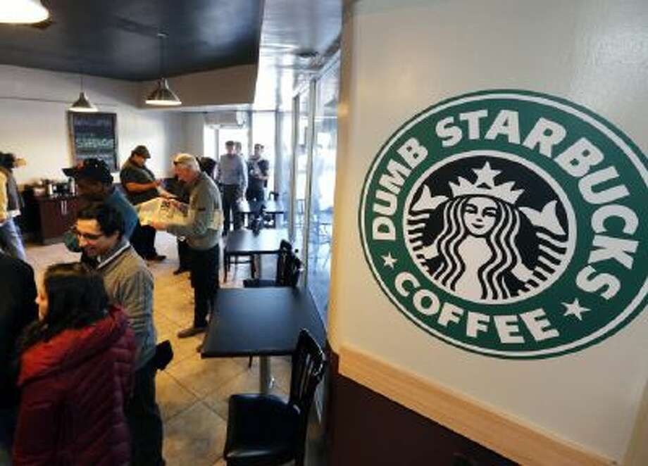 People wait at Dumb Starbucks coffee in Los Angeles Monday, Feb. 10, 2014.