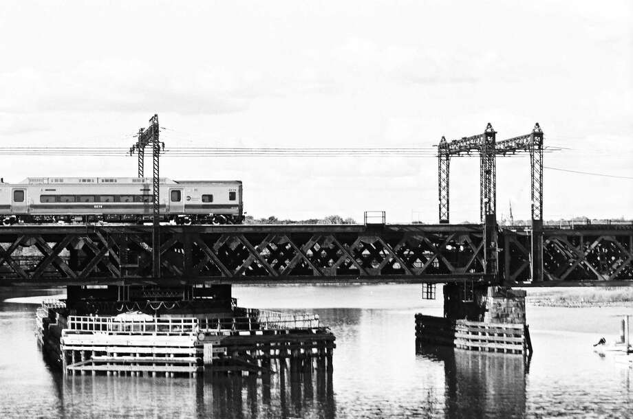 """""""On a tired metal bridge over the Norwalk River, about 45 miles northeast of New York City, underneath a bright sky with gentle clouds, a new, sleek Metro-North train was passes through."""" Ricky J. McRoskey/Contributed Photo Photo: Journal Register Co."""