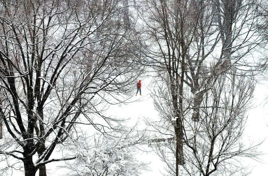 A person crosses the snow covered Upper Green in New Haven Monday. Photo: Arnold Gold — New Haven Register