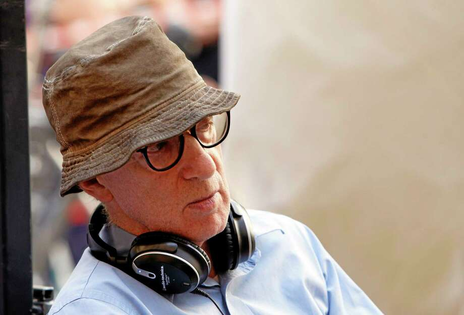 "FILE - In this July 14, 2011 file photo, filmmaker Woody Allen is shown on the set of his movie ""The Bop Decameron"" in Rome. Dylan Farrow, the adopted daughter of Allen and Mia Farrow, penned an emotional open letter, accusing Hollywood of callously lionizing Allen, who she claims abused her. The letter revived in stunning detail an allegation more than two decades old. (AP Photo/Andrew Medichini, file) Photo: AP / AP"