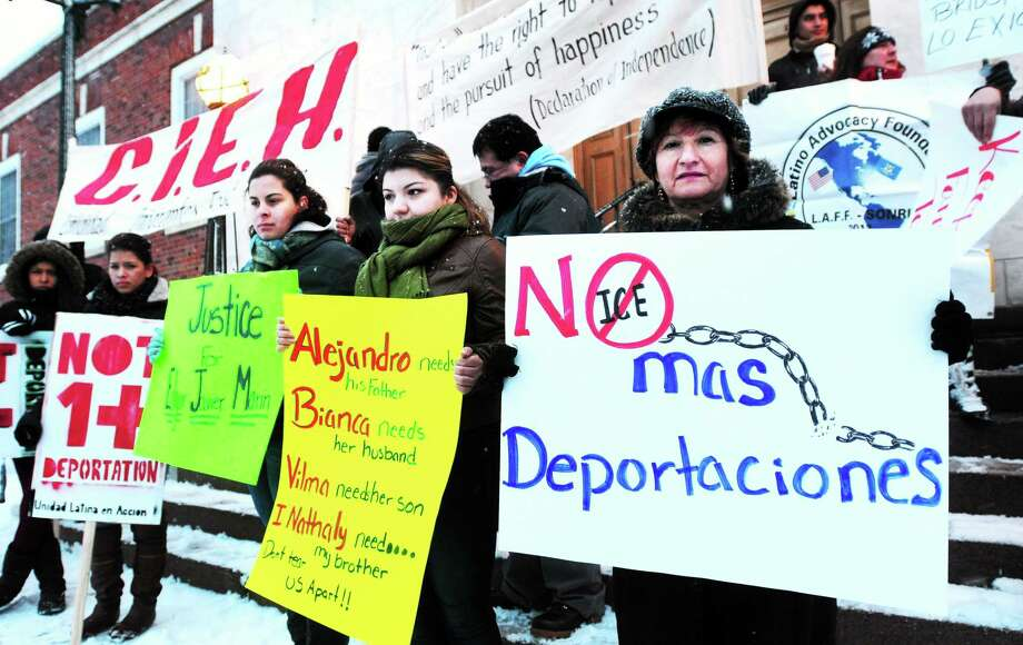 Left to right, Edgar Javier Marin's wife, Bianca Torres, sister, Nathaly Marin, and mother, Vilma Marin, protest his detention by ICE in front of East Haven Town Hall on 2/3/2014. Photo: Arnold Gold — New Haven Register