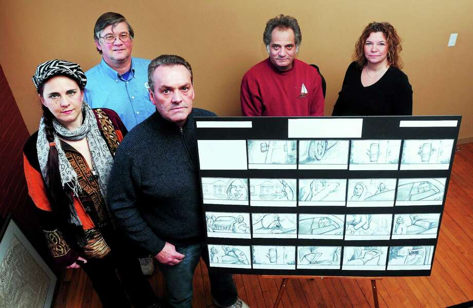 """(Arnold Gold — New Haven Register) Left to right, Tess Ahlberg, wardrobe, Tom Moore, line producer, Jim Amann, producer/director, Wayne Holmes, art director, and Stephanie Dodding, director of operations for L.A. Productions & Entertainment, are shown with a story board for an episode of the """"Turnpike Chronicles"""" in Milford recently. Photo: Journal Register Co."""