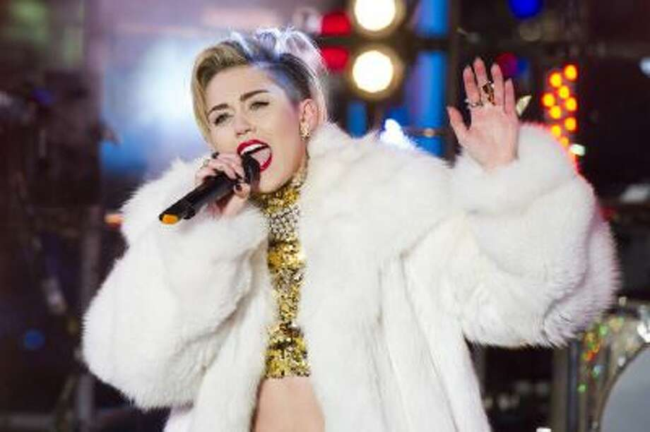 In this Dec. 31, 2013 file photo, Miley Cyrus performs in Times Square during New Year's Eve celebrations in New York.