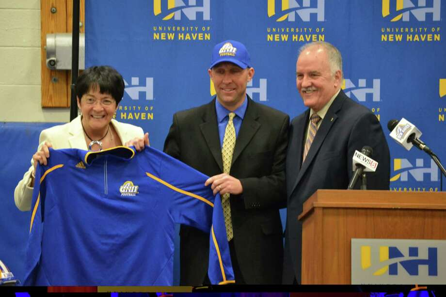University of New Haven athletic director Debbie Chin, left, and vice president for enrollment management Dr. James McCoy, right, introduce Chris Pincince as football coach of the Chargers at a press conference on Thursday. Photo: Photo Courtesy Of New Haven Athletics