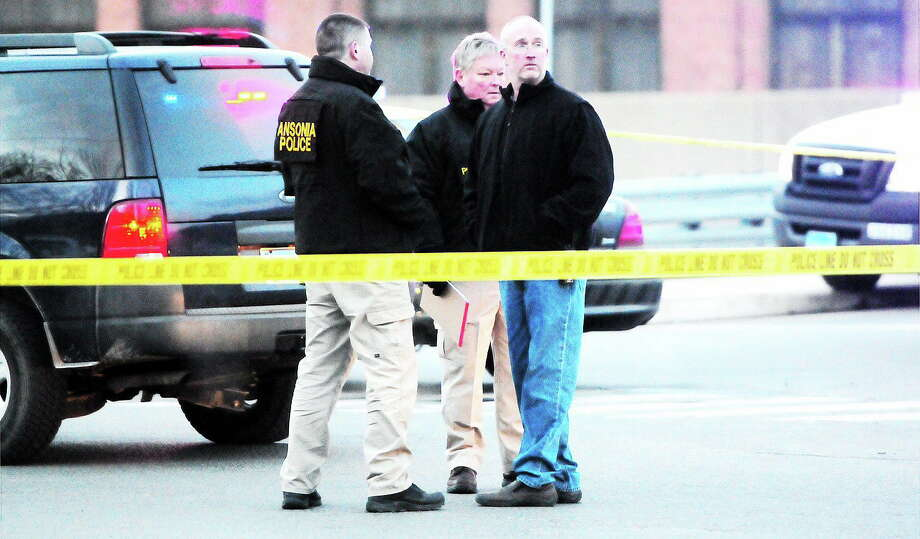 Left, the scene of a shooting on the Maple Street Bridge in Ansonia on Saturday. Below, police close off Maple Street. Photo: Journal Register Co.