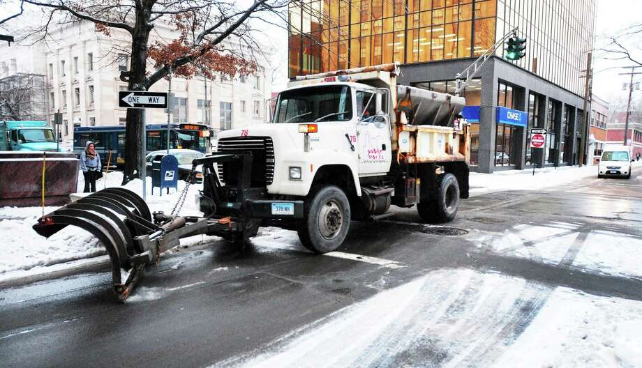(Arnold Gold ó New Haven Register)  A plow clears snow on Wall St. in New Haven Tuesday morning 12/17/2013. Photo: Journal Register Co.