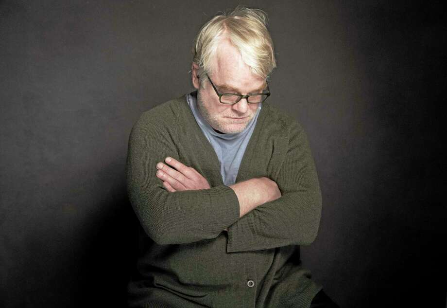 This photo taken Jan. 19, 2014, shows Phillip Seymour Hoffman posing for a portrait at The Collective and Gibson Lounge Powered by CEG, during the Sundance Film Festival, in Park City, Utah.  Hoffman, who won the Oscar for his portrayal of writer Truman Capote and created a gallery of slackers, charlatans and other characters so vivid that he was regarded as one of the world's finest actors, was found dead in his New York apartment Sunday with what officials said was a needle in his arm. He was 46. (Photo by Victoria Will/Invision/AP) Photo: Victoria Will/Invision/AP / Invision
