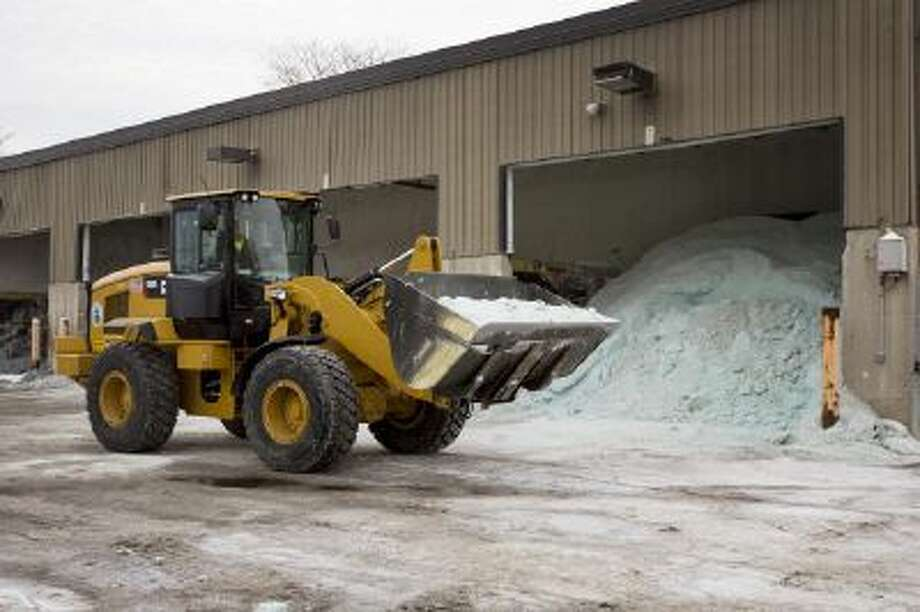 Road salt is unloaded from storage at the public works facility in Glen Ellyn, Ill.