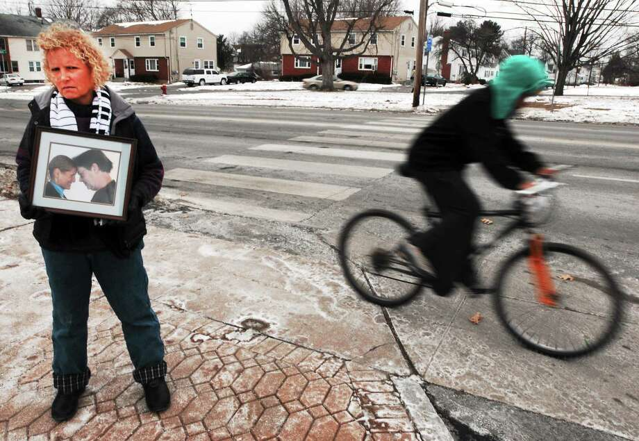 (Photo by Peter Hvizdak — New Haven Register)  Linda Piotrowicz of East Hartford stands near Burnside Avenue and Larrabee Street on Jan. 25 by the crosswalk in front of East Hartford Middle School where her life partner, William Laramie, was killed by a drunken driver while he was riding his bike home from work in September 2011. Photo: New Haven Register / ©Peter Hvizdak /  New Haven Register