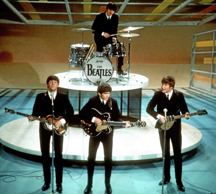 "In this Feb. 9, 1964, photo, The Beatles, from left, Paul McCartney, George Harrison, Ringo Starr on drums, and John Lennon, perform on the CBS ""Ed Sullivan Show"" in New York. Photo: The Associated Press   / AP"
