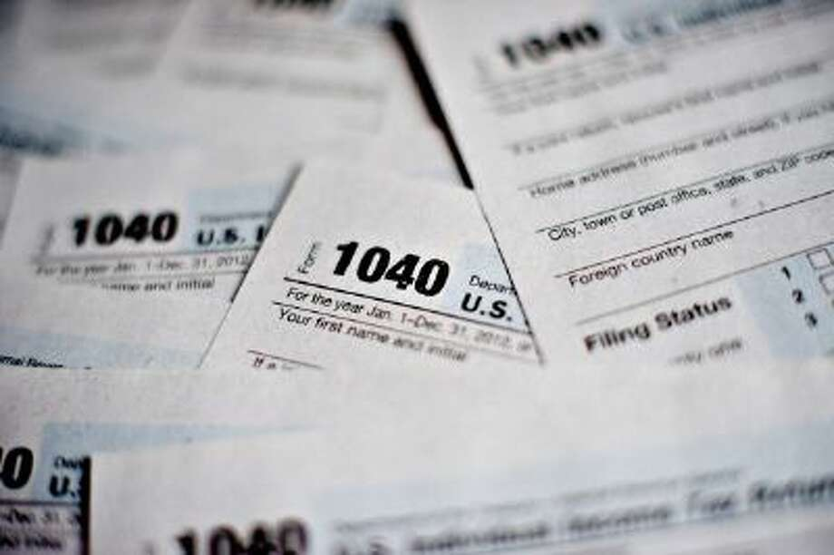 Despite bipartisan support, legislation to make filing your taxes take just 5 minutes is doomed to fail. Photo: Bloomberg Via Getty Images / 2013 Bloomberg