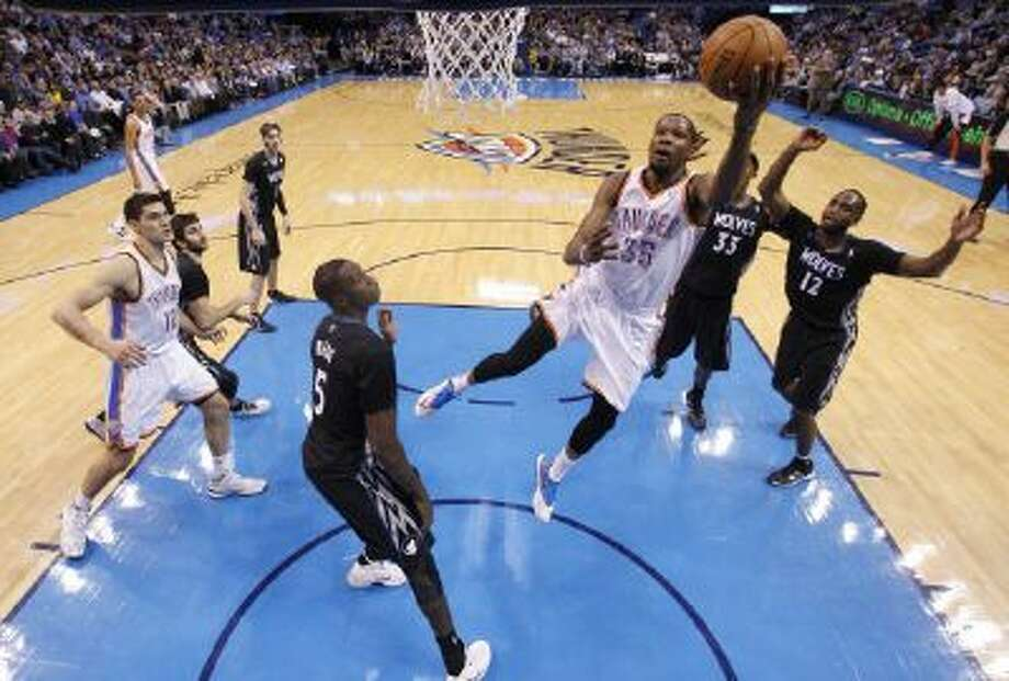 Minnesota Timberwolves center Gorgui Dieng stands there as Kevin Durant scores during Oklahoma City's win Wednesday night.