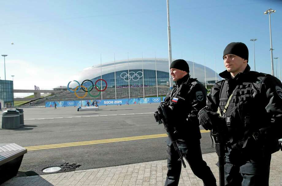 Russian security personnel patrol Olympic park ahead of the 2014 Winter Olympics, Tuesday, Feb. 4, 2014, in Sochi, Russia. (AP Photo/Christophe Ena) Photo: AP / AP