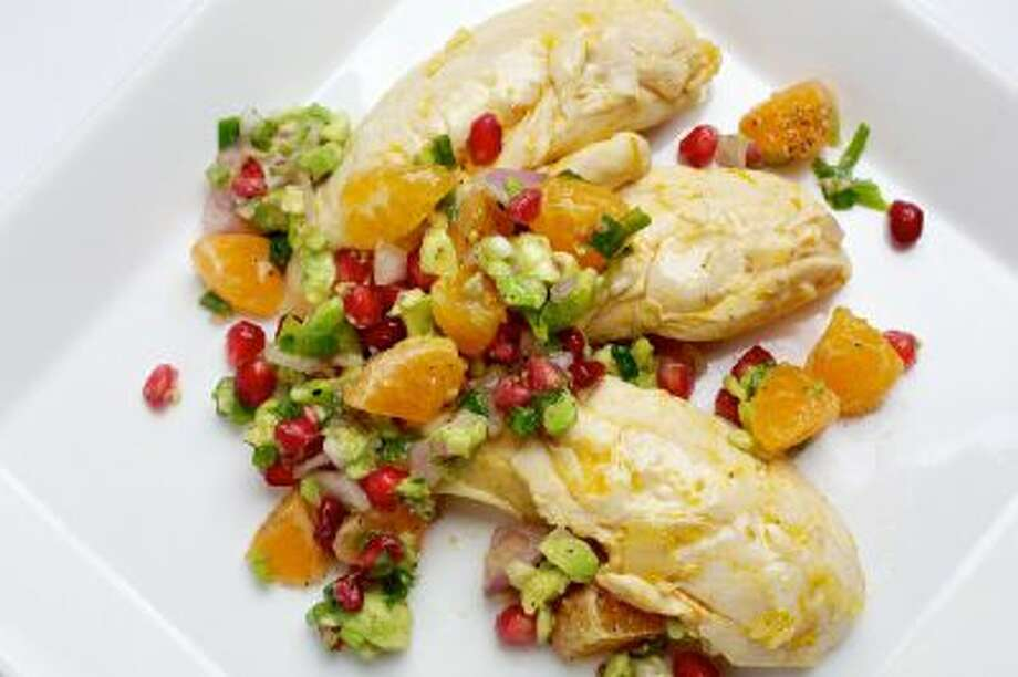 In Tangerine Poached Chicken, the chicken is infused with winter citrus flavor that is enhanced by the sweet clementine-pomegranate relish.
