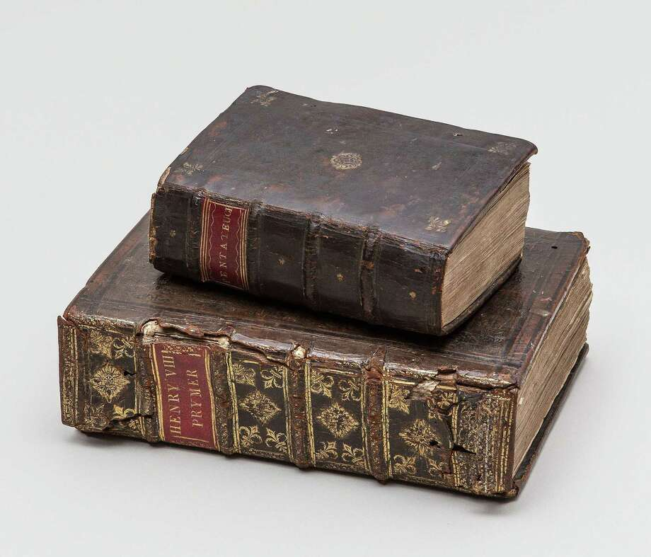 William Tyndale's English translation of the New Testament, bottom, was published in 1536. The Tyndale Pentateuch, top, was published in 1534. The New Testament is bound with a liturgical primer, or daily prayer book. Contributed photo. Photo: Journal Register Co. / 2014
