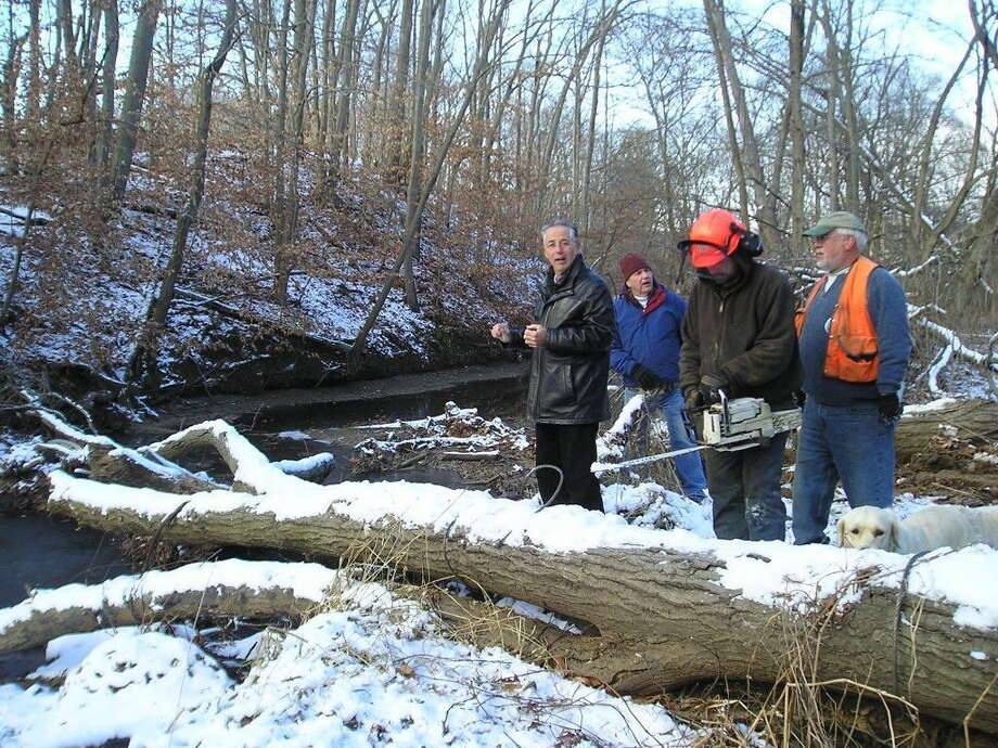 From left, Mayor Joseph Maturo, Town Engineer Kevin White, Sam Bartlett and his crew foreman Greg Harvey of New England Forest Products of Guilford. contributed photo Photo: Journal Register Co.