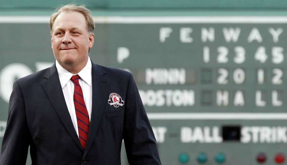 Former star pitcher Curt Schilling looks on after being introduced as a new member of the Boston Red Sox Hall of Fame on Aug. 3, 2012, at Fenway Park. On Wednesday, Schilling announced he was battling cancer. Photo: Winslow Townson - The Associated Press   / FR170221 AP