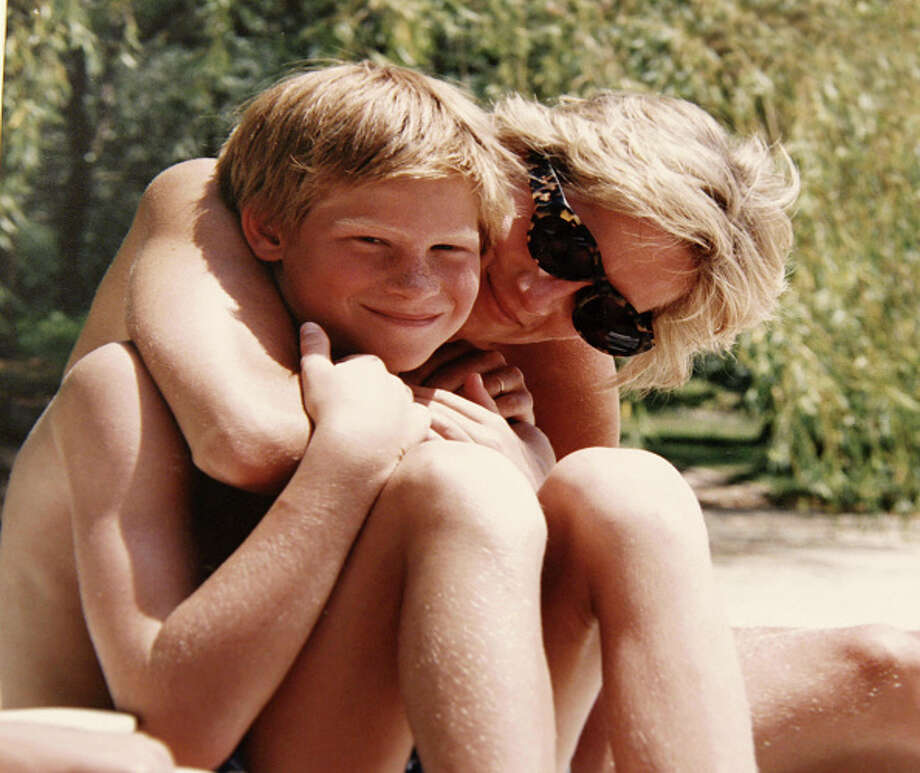 In this handout provided by Kensington Palace, Princess Diana poses for a photo with Prince Harry whilst on holiday. It is from the personal photo album of the late Diana, Princess of Wales and features in the new ITV documentary 'Diana, Our Mother: Her Life and Legacy'. Photo: Handout