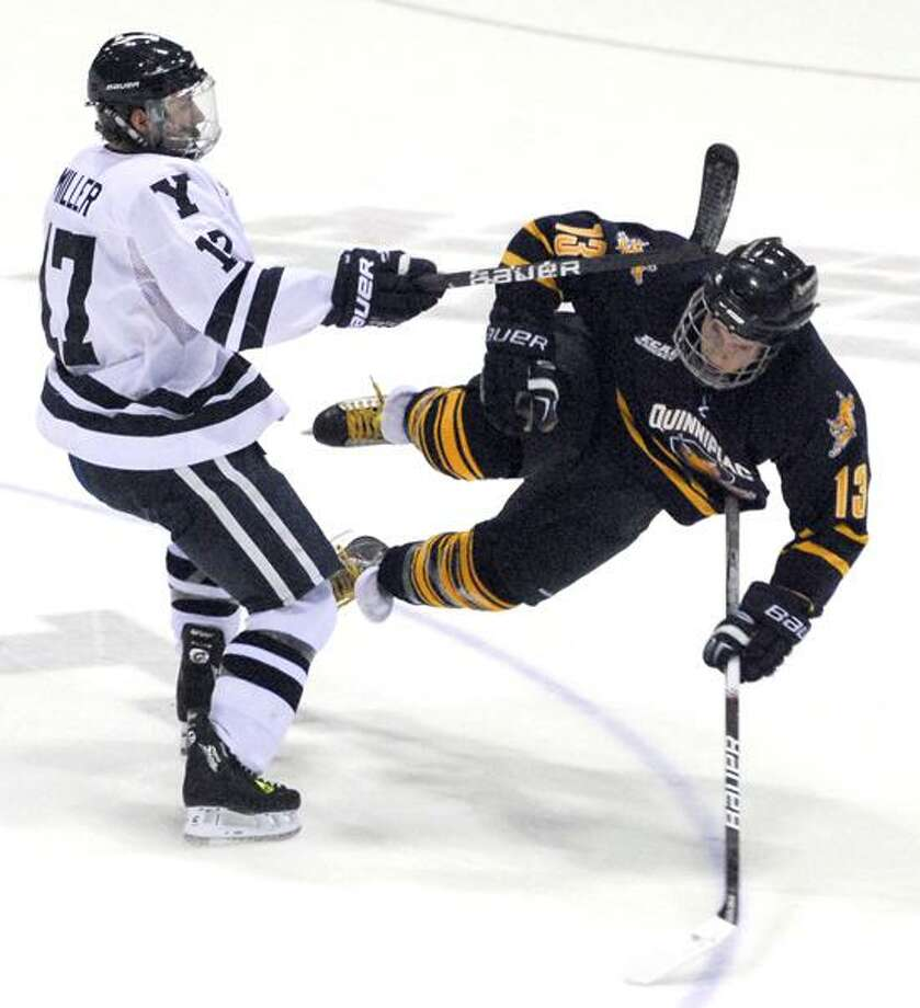 Photography by PETER HVIZDAK   ph1194   #6127New Haven, Connecticut- December 4, 2008: Andrew Miller of Yale University, left, and Quinnipiac University's Yuri Bouharevich collide during ECAC hockey action Friday night at Yale.