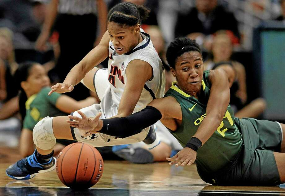UConn's Moriah Jefferson, left, and Oregon's Chrishae Rowe chase a loose ball during their Nov. 20 game in Hartford. Photo: Jessica Hill — The Associated Press   / FR125654 AP