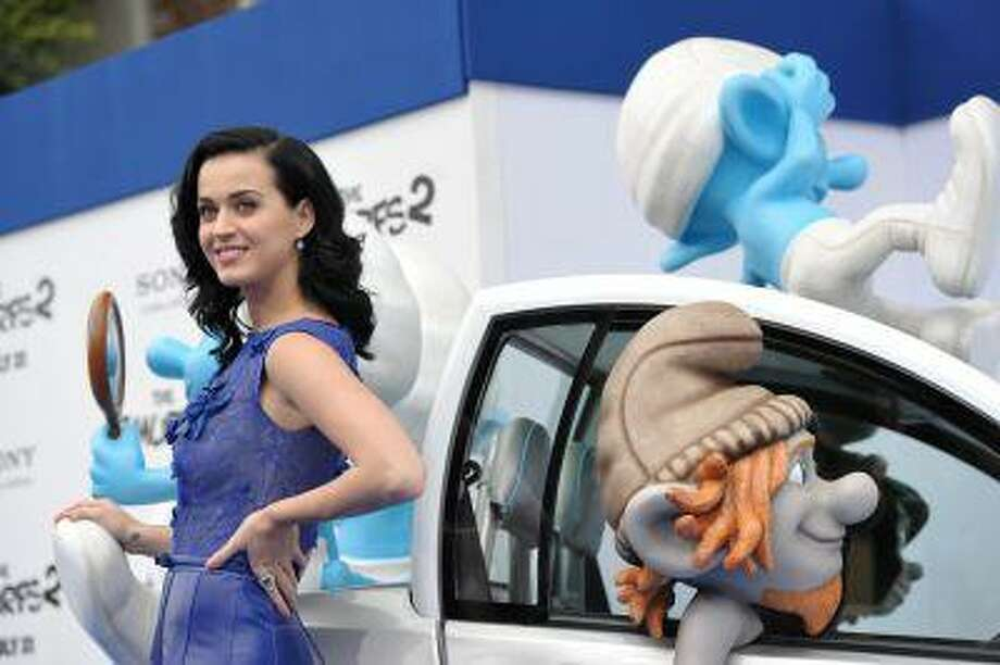 """Katy Perry arrives to the world premiere of """"The Smurfs"""" at the Regency Village Theatre on Sunday, July 28, 2013 in Los Angeles. (Photo by John Shearer/Invision/AP Photo: John Shearer/Invision/AP / Invision"""