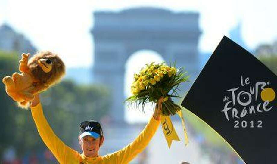 FILE - In this July 22, 2012 file photo, Britain's Bradley Wiggins, winner of the 2012 Tour de France cycling race, poses for photographers on the podium of the Tour de France cycling race in Paris, France. Team Sky said Friday, May 31, 2013 that defending champion Bradley Wiggins will not race in the Tour de France cycling race due to illness and injury. Photo: AP / POOL L'EQUIPE