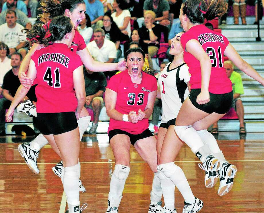 Cheshire celebrates after winning the second game of Monday's match against Amity. Photo: Arnold Gold — Register