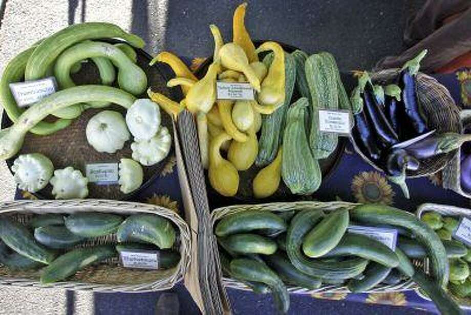 Fresh vegetables are seen at a farmers market in Portland, Ore. Photo: AP / AP