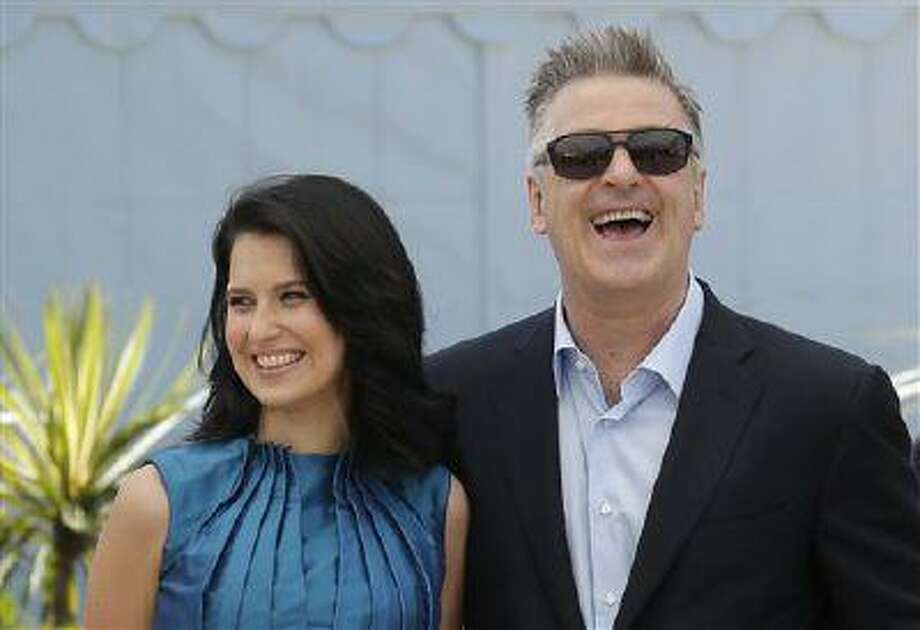 Actor Alec Baldwin, right, and his wife Hilaria Thomas pose for photographers during a photo call for the film Seduced and Abandoned at the 66th international film festival, in Cannes, southern France, Tuesday, May 21, 2013. (AP Photo/Francois Mori) Photo: ASSOCIATED PRESS / AP2013