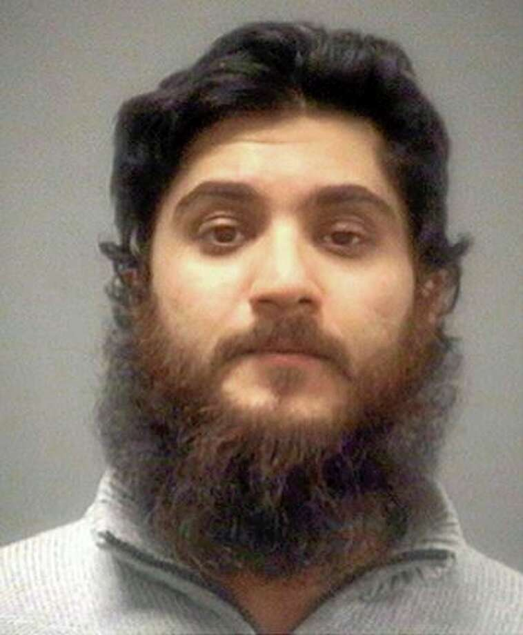 FILE - This undated file photo provided by the Wake County Sheriff's Office via The News & Observer, shows Basit Javed Sheikh. Sheikh, 29, of Cary, N.C., a Pakistani native living in the U.S., is facing federal charges that he sought to join an al-Qaida-linked militant group fighting the regime of Syrian President Bashar Assad. He is charged in a federal criminal indictment with attempting to provide material support to a foreign terrorist organization. He was arrested on Nov. 2 before boarding the first of a series of flights that would take him to Lebanon. (AP Photo/Wake County Sheriff's Office via The News & Observer) Photo: AP / Wake County Sheriff's Office via The News & Observer