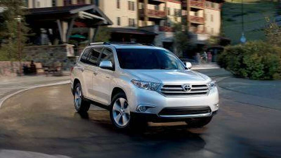 With three rows of seats, a comfortably functional interior and pleasant looks, Toyota's 2013 Highlander is a right-sized, no-fuss vehicle for families. (Toyota)
