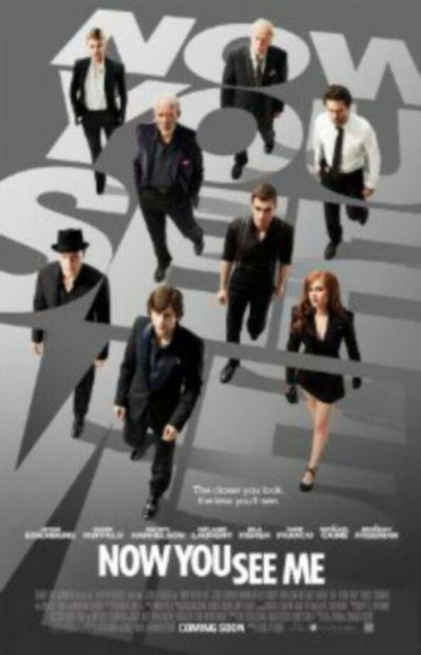 IMDb: An FBI agent and an Interpol detective track a team of illusionists who pull off bank heists during their performances and reward their audiences with the money.