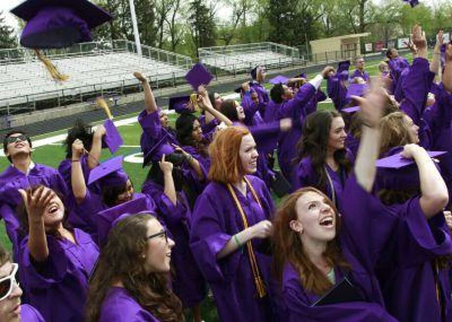 Celebrating at commencement is fine, but do it respectfully. Photo: ASSOCIATED PRESS / AP2013