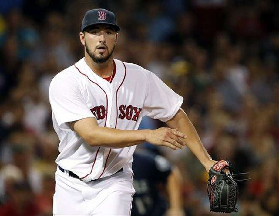 Boston Red Sox starting pitcher Brandon Workman reacts after striking out Seattle Mariners' Justin Smoak to end the top of the sixth inning of a baseball game at Fenway Park in Boston on Tuesday, July 30, 2013. (AP Photo/Elise Amendola) Photo: AP / AP