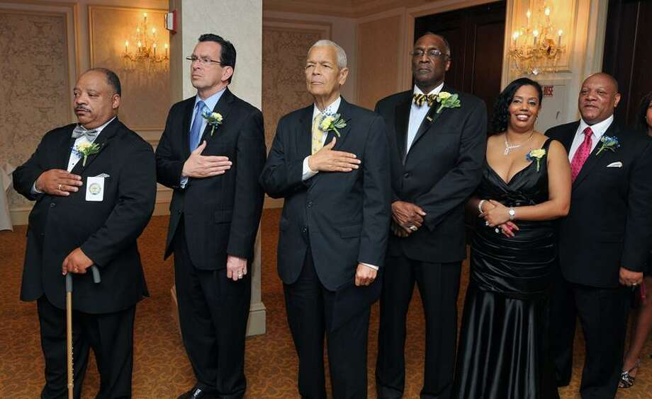 Dignitaries at the NAACP Freedom Fund Dinner listen to the National Anthem at the Omni Hotel in New Haven. They are, from left to right; Anthony Dawson (2nd VP of the Greater New Haven NAACP branch), Gov. Dannel P. Malloy, Julian Bond (keynote Speaker), James Rawlings (President of the Greater New Haven NAACP branch), Dori Dumas (1st VP of the Greater New Haven NAACP branch) and Scott X Esdaile (State President of the NAACP). Peter Casolino/New Haven Register