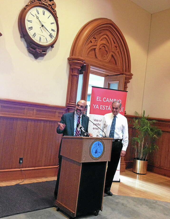 On left is Dr. Mario Garcia - Mayor John DeStefano on right at City Hall discussing that the city will be one of six navigators in state to help with ACA sign up Photo: Journal Register Co.