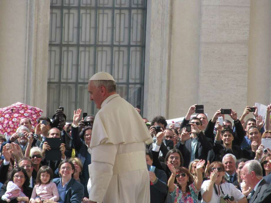 Pope Francis talks to pilgrims.