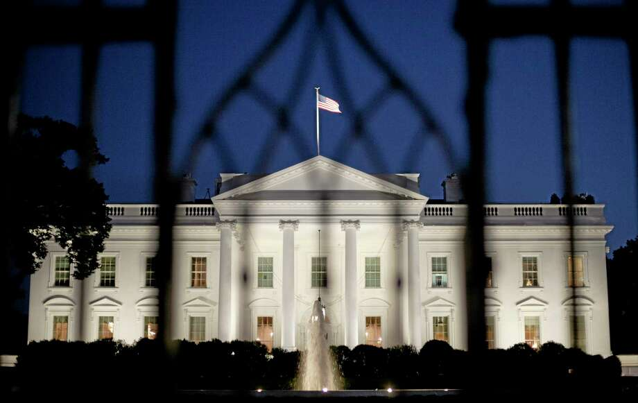 The White House in Washington is seen at night, Monday, Sept. 30, 2013. President Obama is ramping up pressure on Republicans to avoid a post-midnight government shutdown, saying a shutdown would hurt the economy and hundreds of thousands of government workers. (AP Photo/Pablo Martinez Monsivais) Photo: AP / AP