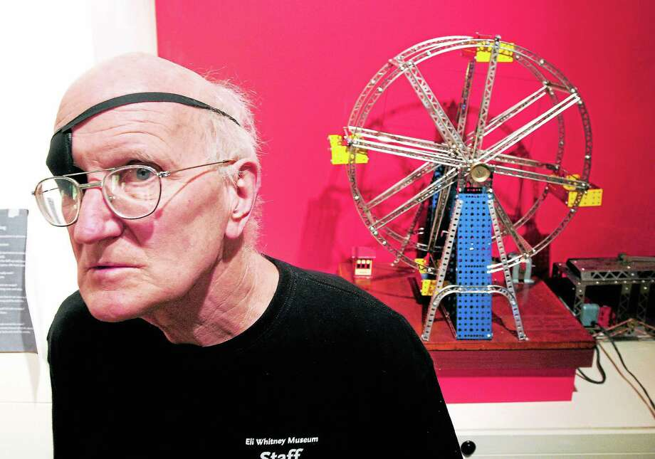 Bill Brown, director of the Eli Whitney Museum, stands in front of an Erector Set ferris wheel on exhibit at the museum in Hamden. Photo: Arnold Gold — New Haven Register