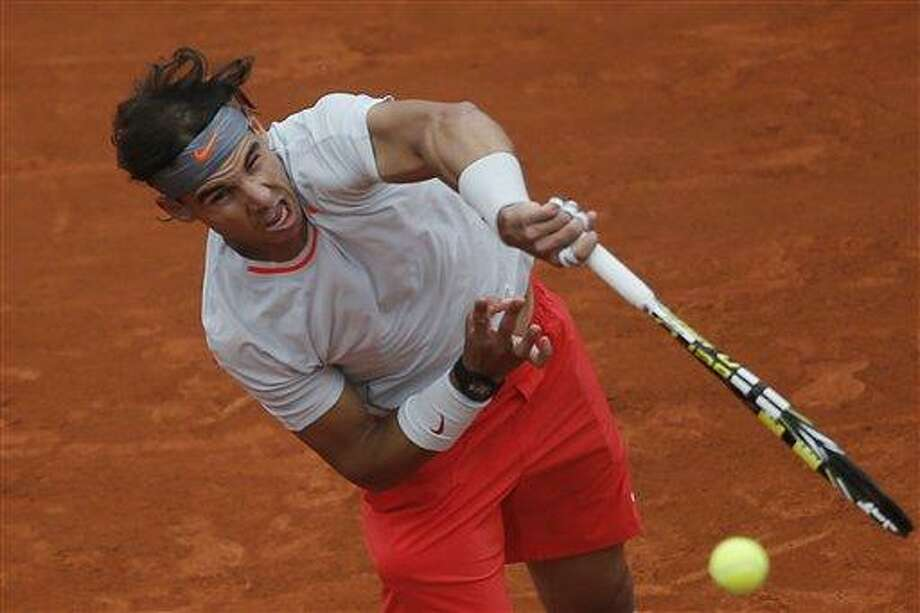 Rafael Nadal of Spain serves against Slovakia's Martin Klizan in their second round match at the French Open tennis tournament, at Roland Garros stadium in Paris, Friday, May 31, 2013. (AP Photo/Michel Spingler) Photo: AP / AP