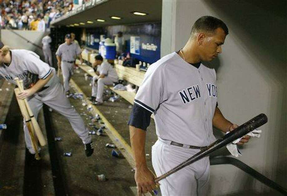 FILE - In this Aug. 24, 2006 file photo, New York Yankees' Alex Rodriguez leaves the dugout after a 4-2 loss to the Seattle Mariners in Seattle. Major League Baseball has told the union which players it intends to suspend in its drug investigation and which ones will receive lengthier penalties for their roles in the Biogenesis case. (AP Photo/John Froschauer, File) Photo: AP / AP
