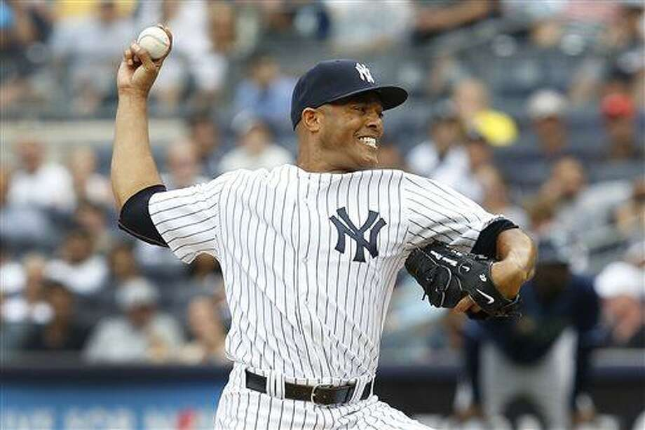 New York Yankees relief pitcher Mariano Rivera throws in the ninth inning of a baseball game against the Tampa Bay Rays, Sunday, July 28, 2013, in New York. The Yankees defeated the Rays 6-5. (AP Photo/John Minchillo) Photo: AP / FR170537 AP