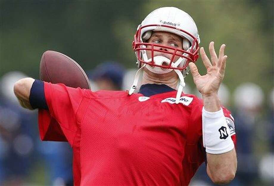 New England Patriots quarterback Tom Brady pass during team football practice in Foxborough, Mass., Wednesday, May 29, 2013. (AP Photo/Michael Dwyer) Photo: AP / AP
