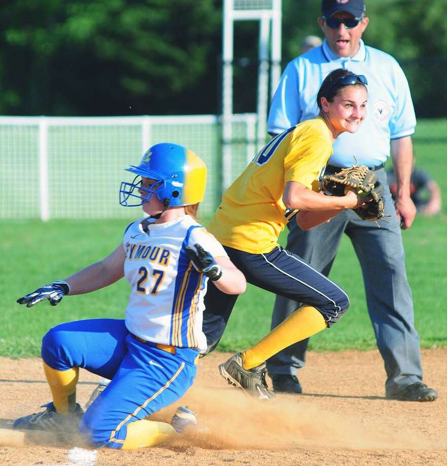 Carissa Wasikowski (left) of Seymour is the final out on a force at third base against East Haven in a Class M quarterfinal on 5/31/2013.  Making the play is East Haven third baseman Allison Luzzi.Photo by Arnold Gold/New Haven Register