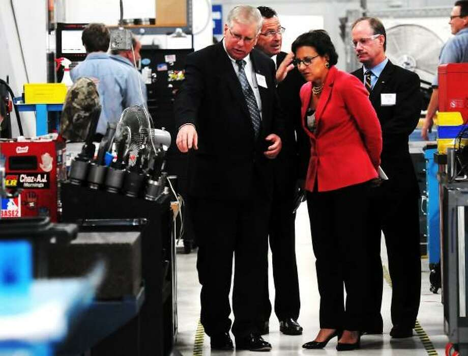 July 30, 2013. US Commerce Secretary Penny Pritzker toured APS Technology in Wallingford with APS president William Turner, CT Governor Dannel Malloy and vice president Denis Biglin.  Mara Lavitt/New Haven Register