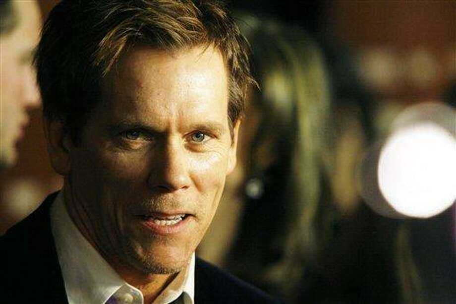 """Actor Kevin Bacon attends the world premiere of """"The Following"""" event, at the New York Public Library on Friday, Jan. 18, 2013 in New York. (Photo by Andy Kropa/Invision/AP) Photo: Andy Kropa/Invision/AP / AP2013"""