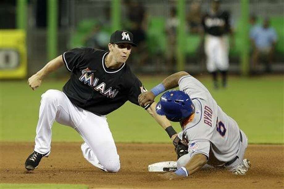 Miami Marlins shortstop Ed Lucas, left, tags out New York Mets' Marlon Byrd (6) stealing second base in the fifth inning of a baseball game, Friday, May 31, 2013, in Miami. (AP Photo/Alan Diaz) Photo: AP / AP