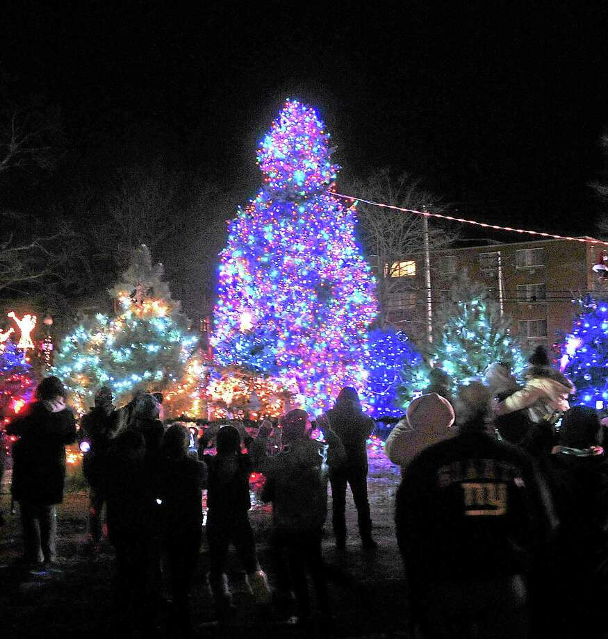 Peter Casolino — New Haven Register     The West Haven Christmas tree is lit on the Green Saturday night. Photo: Journal Register Co.